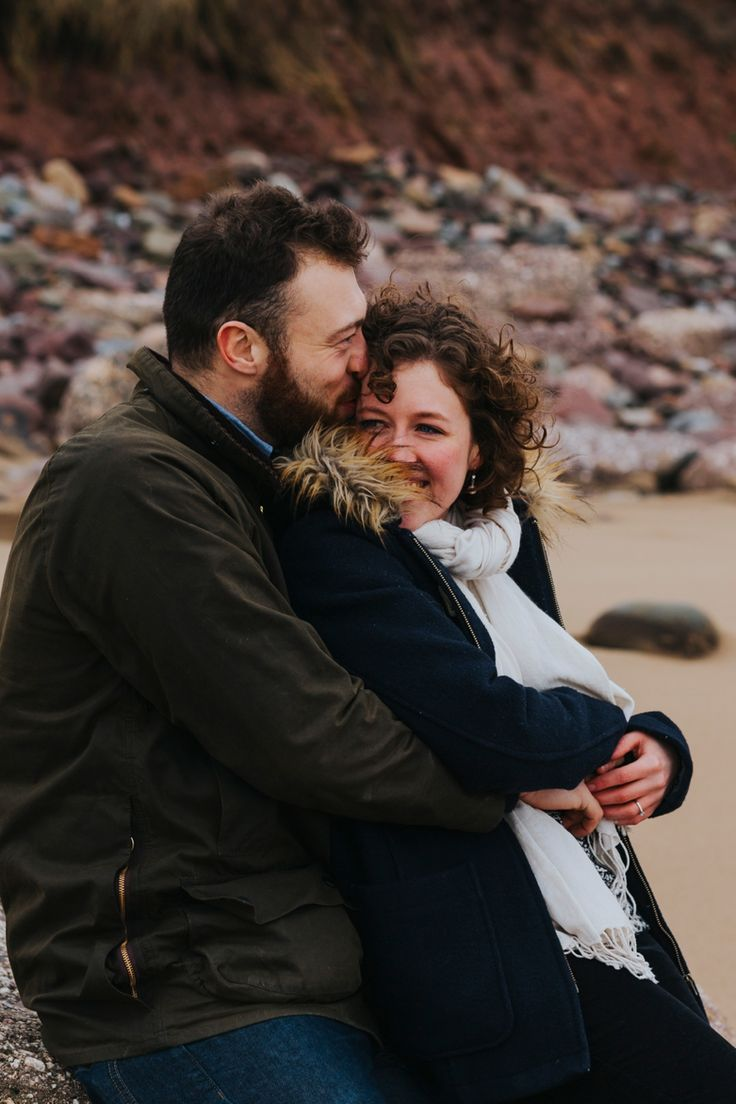 Those smiling eyes say it all. Taken in Rhossili Bay, Gower Peninsula. Photo by Benjamin Stuart Photography #weddingphotography #hug #gower #engagement #couple