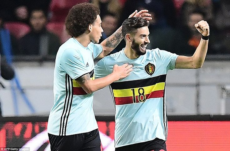 Carrasco beams with delight and is congratulated by Belgium team-mate Axel Witsel after scoring an equaliser late on