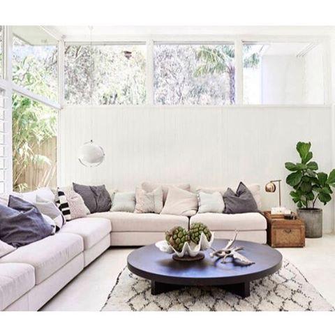 Fresh living room, white sofa, indigo blue textile, Moroccan rug