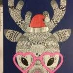 Teaching Resource: A fun Christmas craft activity using a reindeer with funky glasses and a Christmas hat.
