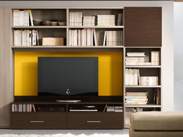 Libreria 73 - Ferrimobili. Esplicita eleganza: linearità e armonia delle proporzioni caratterizzano questa soluzione che include anche una pratica scrivania e un mobile per il televisore.