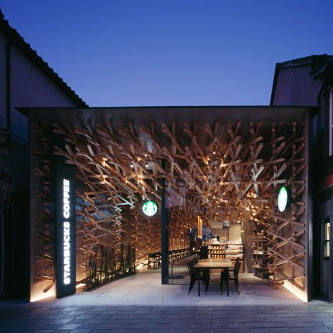 Starbucks Japan. Over 2000 wooden batons line the interior of the shop, creating a diagonally woven lattice that spikes out beyond the recessed glass facade. Architects Kengo Kuma and Associates.
