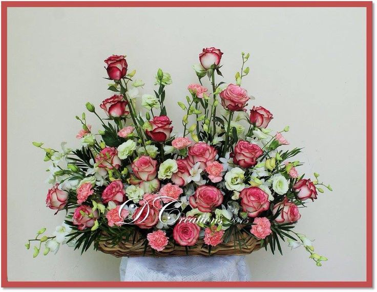 Two tone maroon roses, pink carnation, white eustomas and lilies
