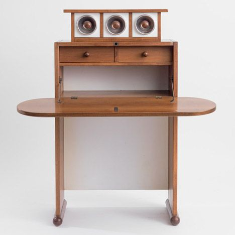 Earlier works are made of natural materials like rosewood, walnut, bronze, and terracotta.