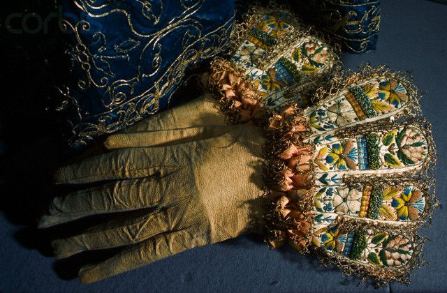 Elizabeth I Gloves. A pair of gauntlet gloves that once belonged to Elizabeth I are decorated with embroidered flowers on the cuff.
