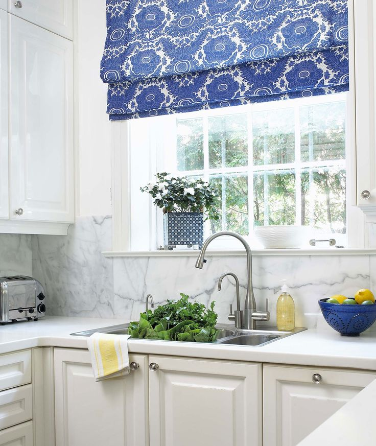beautiful blue & white kitchen,I so wish they would have brought the window down to countertop, think of the green outside coming in and the light!