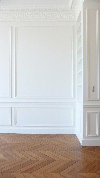 Herringbone floors white moulding.