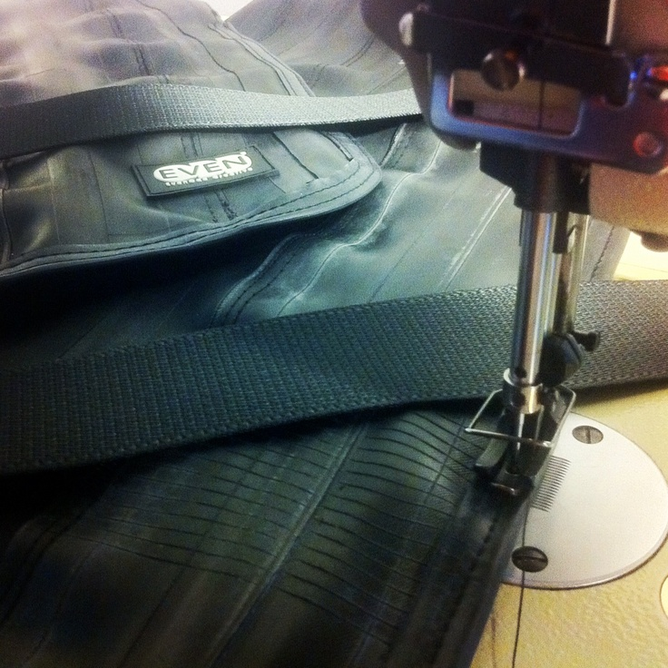 Working on a bag made from upcycled bike inner tubes