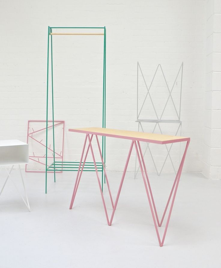Steel powder coated Giraffe console table in pink / plywood top by &New. Stand 50.