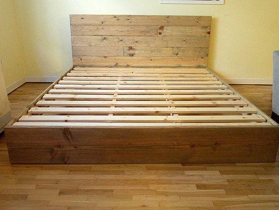 Rustic platform bed frame with headboard built by hand On the floor bed frames