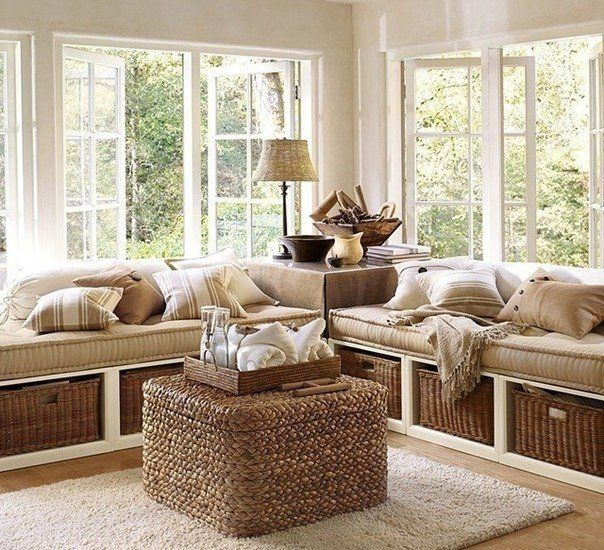 Sun Room Project Cozy Livingroom With Large Window Seats Built In Storage Cubbies For Wicker Baskets A Ottoman Doubling As Coffee Table