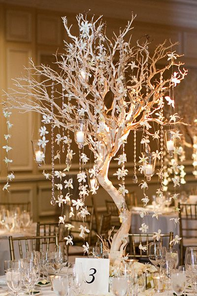 Add a few orchids as accents on a branch centerpiece— they'll look like falling snowflakes.
