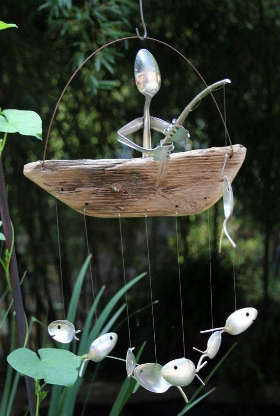 fisherman and fish windchime out of scrap wood and silverware