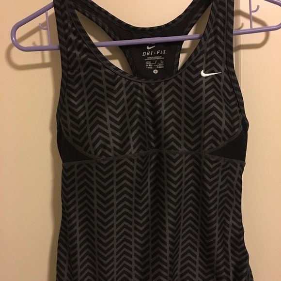 final price  Nike tank Nike dri fit design tank top. Size in tag is small 4-6 the inside brand and size is coming apart it is built in the top. Body is polyester and spandex. Mesh is polyester and spandex. Bra is polyester bra insets polyester bra cup polyester and spandex. This is great for working out has inside bra. Logo at bottom says dri fit and swoosh towards top. Excellent shape besides the inside brand/size writing coming off  no returns final sale Nike Tops Tank Tops