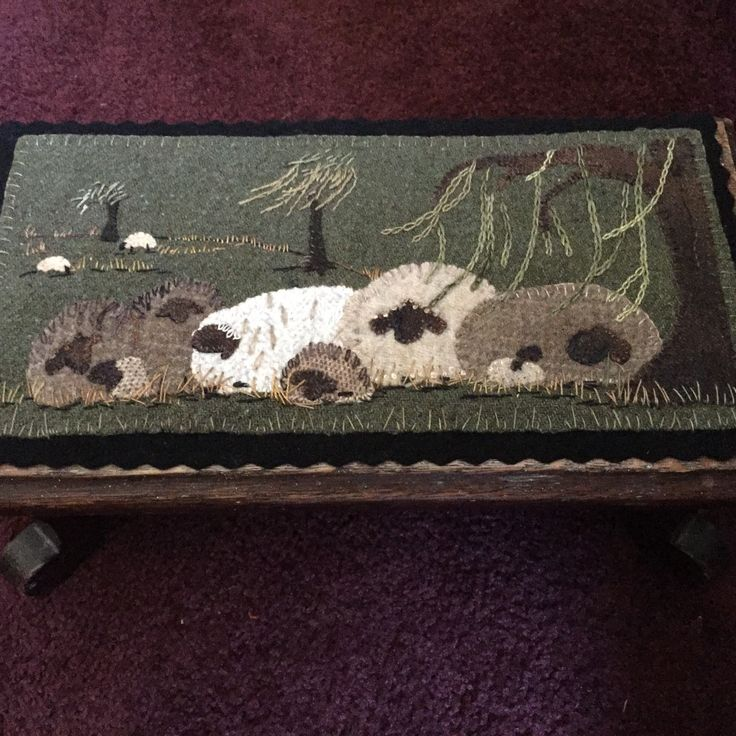 "New pattern called ""Ewe love willows"" I placed it in a small wooden foot stool. Finished size is 7""x14"""