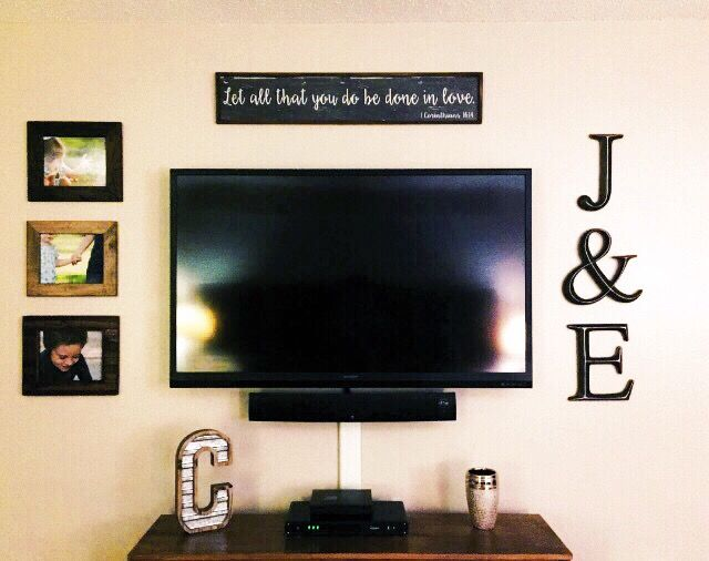 Simple photo wall decor around tv
