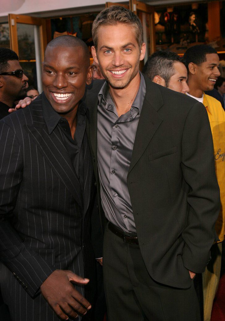 Pin for Later: Paul Walker's Memorable Hollywood Moments  Paul Walker posed with Tyrese Gibson at the LA premiere of 2 Fast 2 Furious in June 2003.