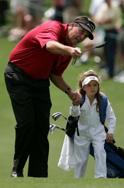 Phil Mickelson walks with his daughter at Augusta in 2005 photo w/ story of him giving his golf ball to a 9 year old who broke his arm! Phil is pure class!♥