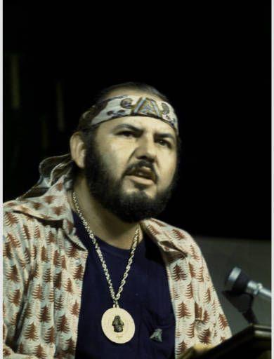 Ricardo Sánchez speaking at a lecturn, Los Angeles, 1973 :: Festival de Flor y Canto de Aztlan, Films and Photographs, 1973