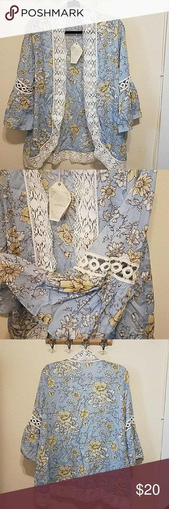 Blue floral kimono Light blue floral kimono with crocheted lace trim and bell sleeves. Hits at forearm, rayon, nwt, tts, Apricot Lane Tops Tunics