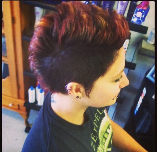 Mohawk wispy sides female haircut texturized chunky highlights black sides red chunks with yellow tips