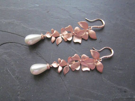 Make a statement with these pearl rose gold drop earrings made with a lovely creamy white shell pearl, rose gold plated brass orchid flower pendant and cubic zircon encrusted earhook.  #rosegoldearrings