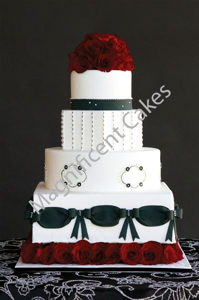 Row of red roses on the bottom is interesting... also the mixture of round and square cakes