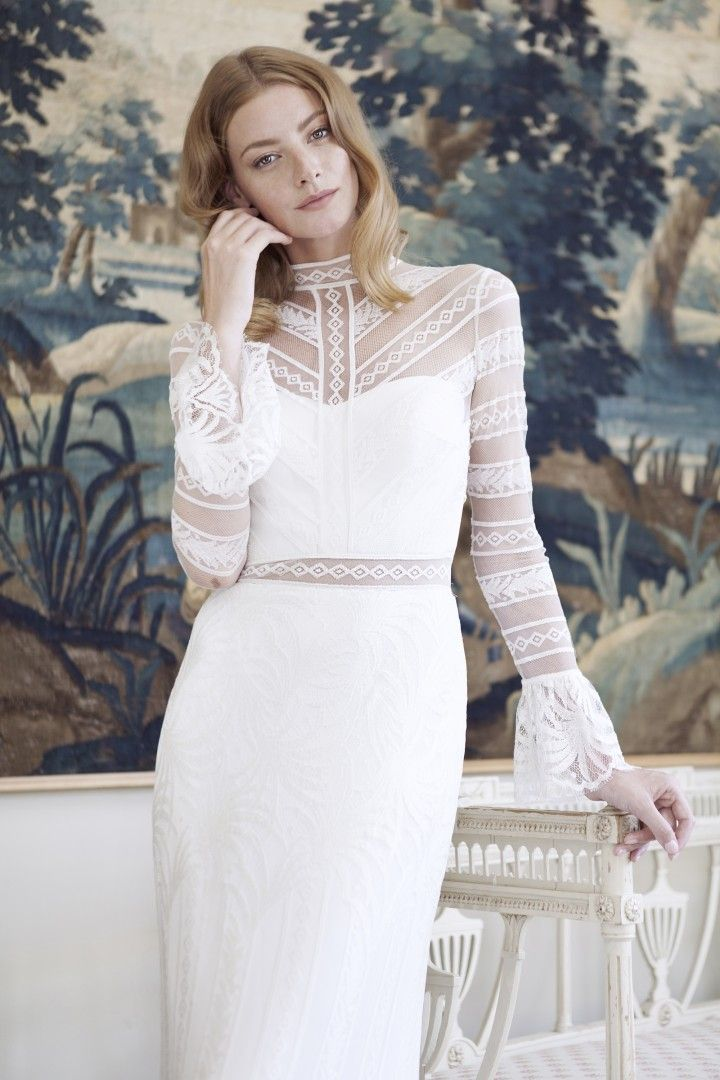 Divine Atelier wedding dress with flared cuff sleeves.