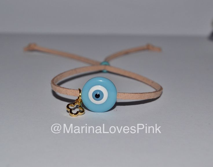 A personal favourite from my Etsy shop https://www.etsy.com/listing/511814172/martyrika-evil-eye-and-cross-suede