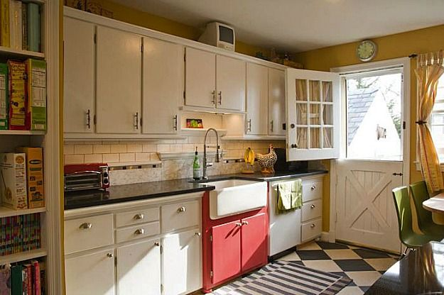 Cozy at it's best - like the Dutch door and the fun red sink cabinet. (Amy's white kitchen with checkerboard floors)
