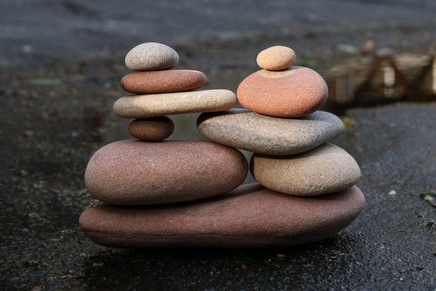 Zen balance sculpture assembled of beautiful naturally tumbled sea stones found on the shore of the Baltic Sea.  Smooth pink and beige pebbles were meticulously selected from all the countless...