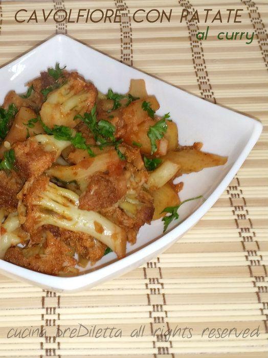 Cavolfiore con patate al curry, ricetta, cucina preDiletta. Ingredienti (5 - 6 persone): cavolfiore viola, 1 di circa 1 kg patate, 3 cipolla, 1 pomodoro, 1 olio extravergine d' oliva, 3 - 4 cucchiai curry, 1 cucchiaino paprica dolce, 1/2 cucchiaino prezzemolo, 1 ciuffo sale, q.b.