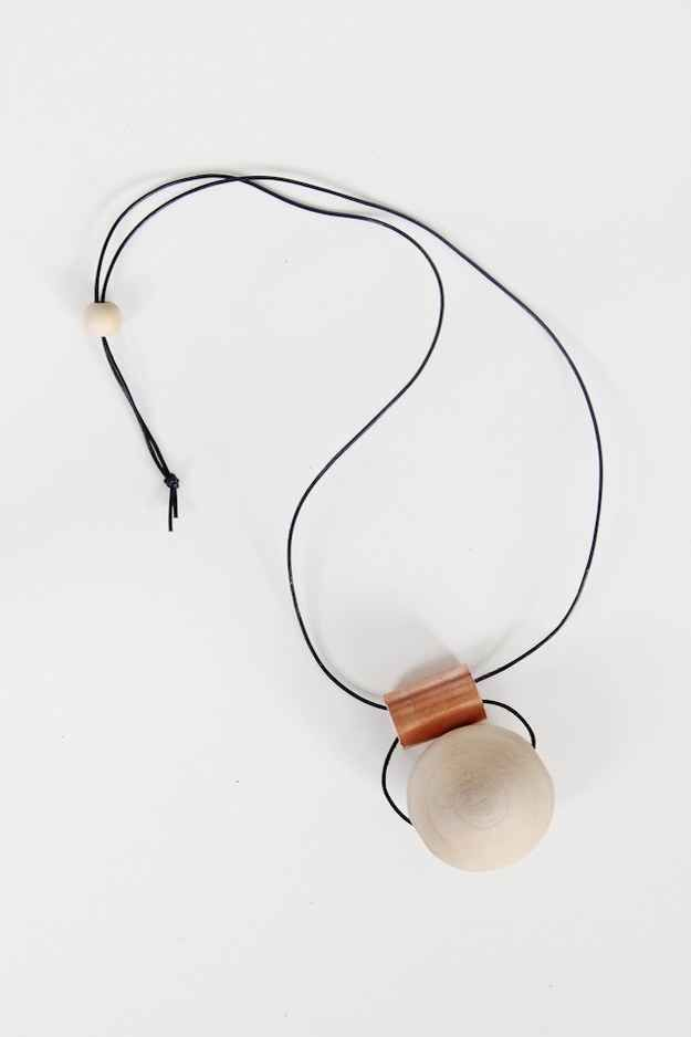 This copper tube and wooden bead necklace is raw, simple, and modern.