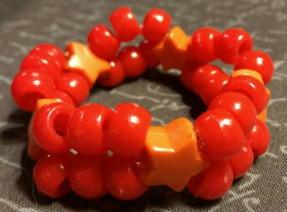 Check out this item in my Etsy shop https://www.etsy.com/listing/261636426/kid-kandi-orange-star-beads-red-pony