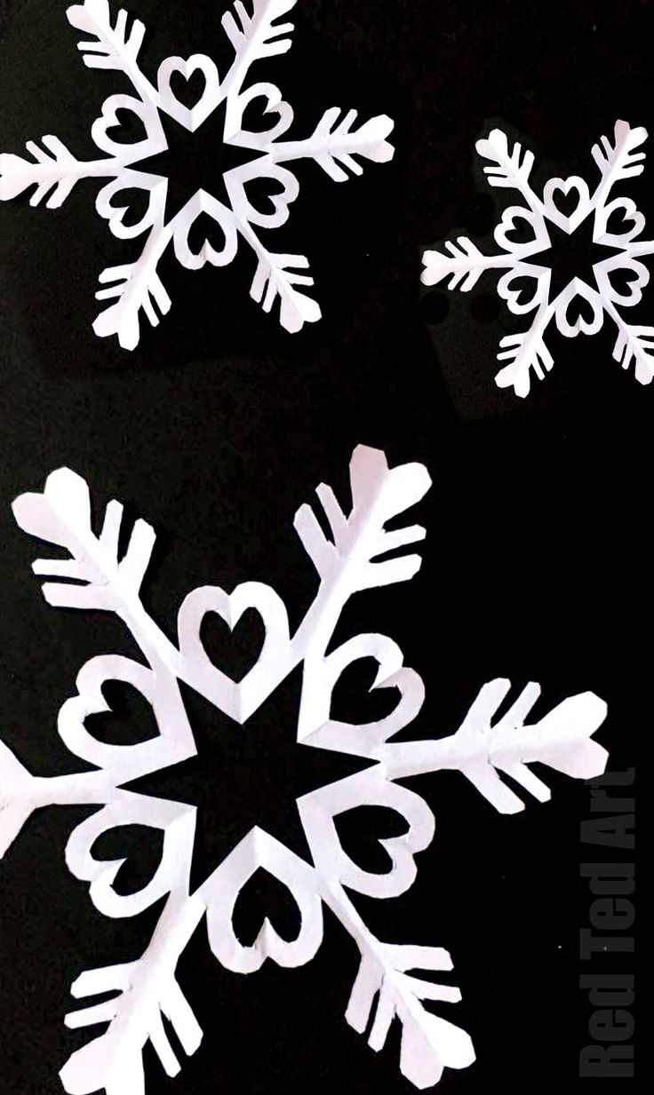 How to make paper snowflakes - we love 6 pointed snowflakes as they are that little bit more special. Here we show step by step instructions of how to cut a snowflake from paper. #Snowflake #papercrafts #papersnowflakes #winter #christmas #winterdecor #papercraftskids