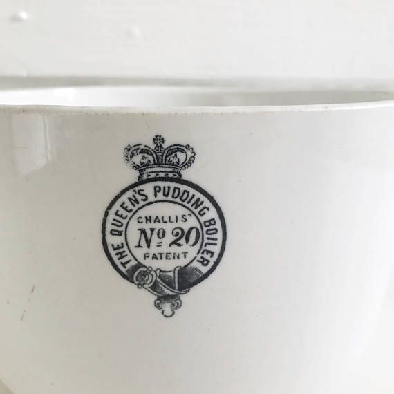 A late Victorian or Edwardian large pudding boiler ceramic bowl with transfer label reading 'The Queen's Pudding Boiler, Challis' No 20 Patent'. This ceramic pudding boiler base is missing its tin lid, but is perfectly serviceable as a bowl for serving desserts, salads, vegetables or simply for display. It has a beautifully transfer label in clear, bright condition. There are just a few small speckles of discolouration to the glazed bowl and a small chip on the foot (see pictures). This is…