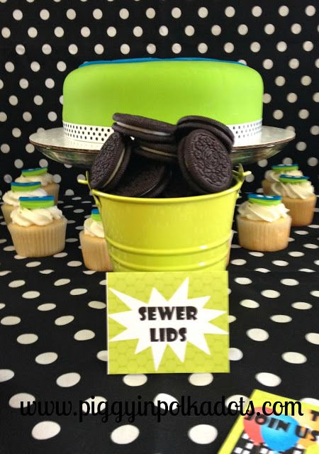 """For a fun twist on your Teenage Mutant Ninja Turtles party snacks, try putting chocolate cream sandwiches in a bucket and labeling them as """"Sewer Lids""""!"""