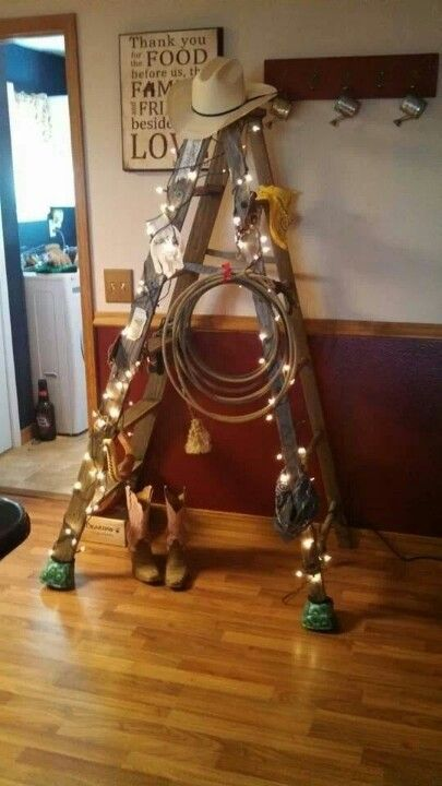 Rustic ladder, a little of this and a little of that, add lights and you have yourself a Texas Cowboy Christmas tree!