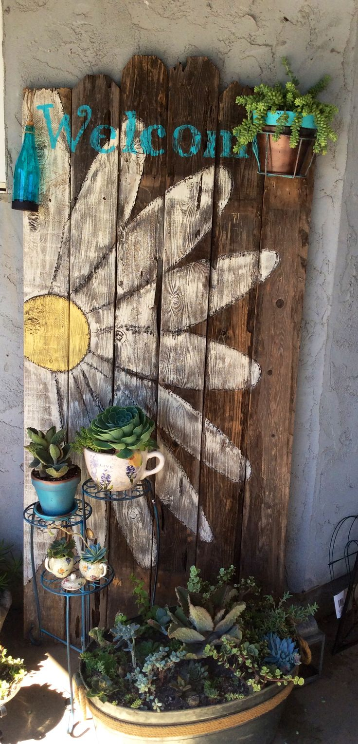 Fence boards and succulents- great combination