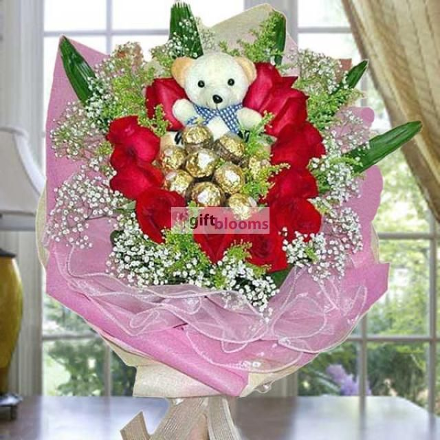 11 Red Roses with 9 Ferrero Roche and Bear Hand Bouquet. Flowers With Same Day delivery Is available.