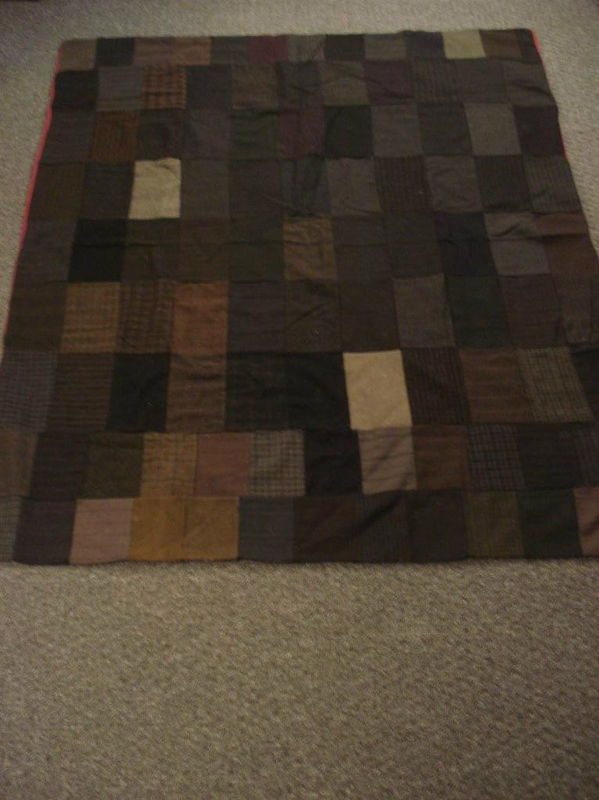A 1920's utility quilt Utility quilts were made for hard use - they are practical, sturdy & warm.  The backing is crimson cotton. No batting. The top is not quilted to the back. The backing & top are handstitched together along all 4 sides. The fabric used is from men's suit material.  dark gray, gray, black.  browns. Solids, houndstooth checks, pinstripes, plaids, herringbone weaves.