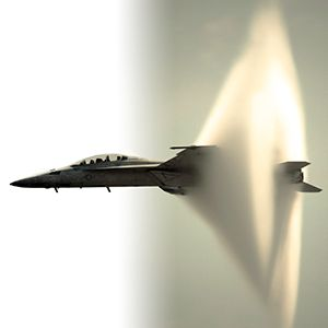 This is what a sonic boom looks like - when an aircraft is near the sound barrier, an unusual cloud sometimes forms in its wake. A Prandtl-Glauert Singularity results from a drop in pressure, due to shock wave formation. This pressure change causes a sharp drop in temperature, which in humid conditions leads the water vapor in the air to condense into droplets and form the cloud.