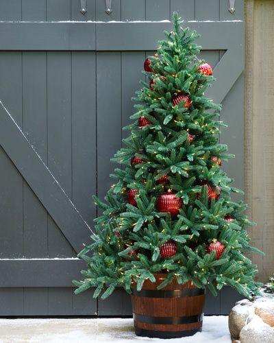 Our Wine Barrel Rolling Tree Stand is as functional as it is decorative.