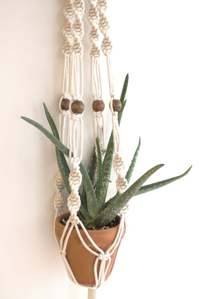 Hanging this cute couple in a window is a great way to display the handcrafted macramé and give your plant some sun!
