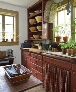 Country Kitchen...love the homespun skirt under the sink  the yellow ware on the open shelves.