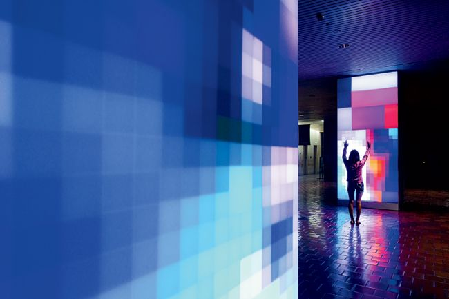 Art imitates life in surprising ways. For Miami residents hurrying through the lobby of the city's 1985 Stephen P. Clark Government Center lobby, Reflect, a permanent, interactive installation by artist Ivan Toth Depeña, does it by capturing their movements in real time, and transforming them into dynamic video paintings that illuminate the building's columns with vivid moving pixels.
