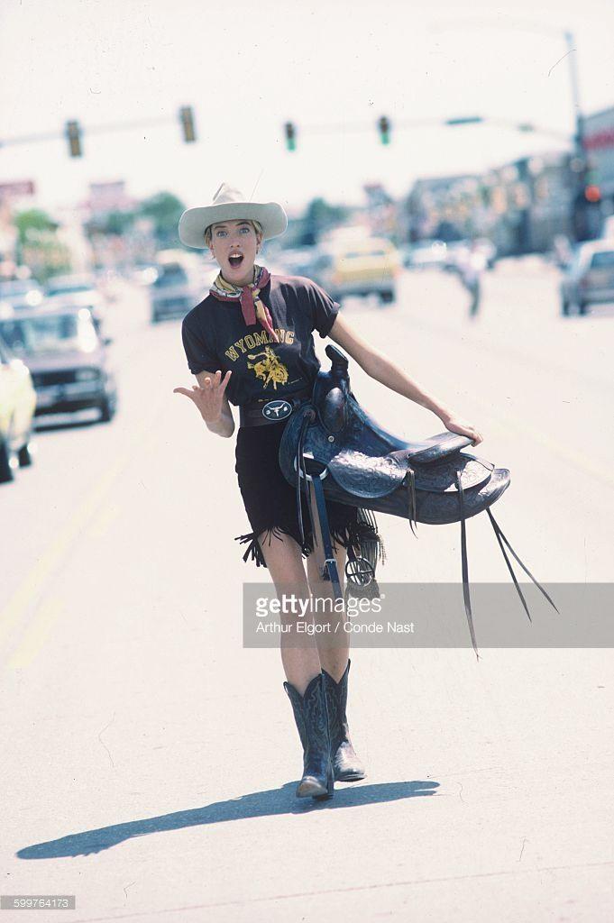News Photo : Model Tatjana Patitz carrying a saddle, walking...