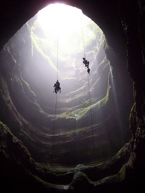 The 162' Neversink Pit in Alabama. In the summer time, there are glow worms in the walls of the pit and it is best to go there on a clear, moonless night. Rappel to the bottom and sit in the middle of the pit for about 15-20 minutes with your lights off and you will see the entire pit glowing once your eyes adjust.