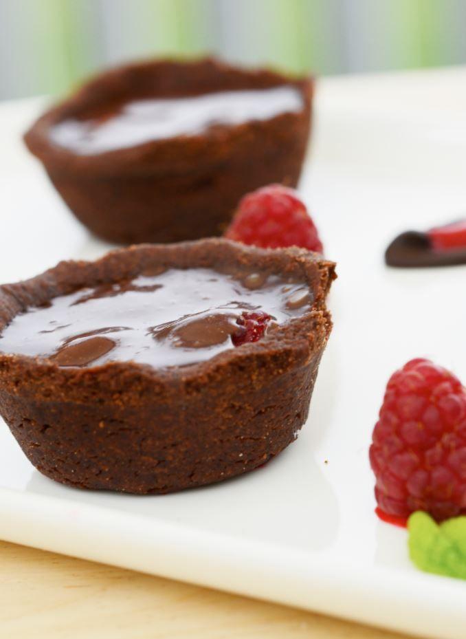 The raspberries make these chocolate tarts pop!