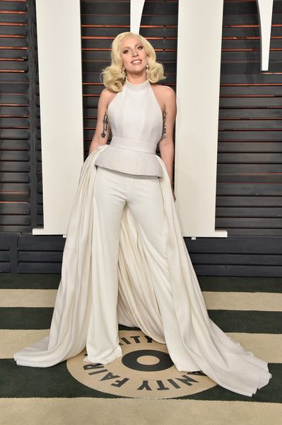 Lady Gaga Halter Top - Lady Gaga rocked a white Brandon Maxwell ensemble, consisting of a molded halter top with a matching train and trousers, at the Vanity Fair Oscar party.